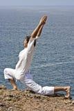 Yoga posture on the rocks. At the atlantic ocean Royalty Free Stock Image
