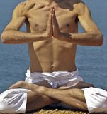 Yoga Posture on the rocks Stock Image