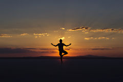 Yoga posture on sunset by man.  Royalty Free Stock Photo