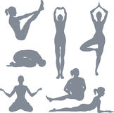 Yoga postures. A set of yoga postures silhouettes Royalty Free Stock Image