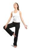 Yoga practicante de la mujer sobre blanco Imágenes de archivo libres de regalías