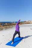 Yoga Practice on the Beach Royalty Free Stock Image