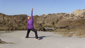 Yoga Practice on the Beach stock video footage