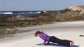 Yoga Practice on the Beach stock video