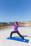 Yoga Practice on the Beach Royalty Free Stock Images
