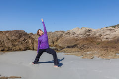 Yoga Practice at the Beach Royalty Free Stock Photo