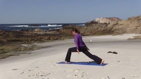 Yoga Practice on California Beach stock video footage