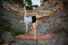Yoga practice. Man doing lateral stretching exercise stock photos
