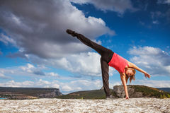 Yoga practice in mountain Stock Photos