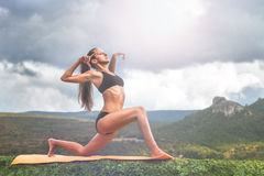 Yoga practice outdoor Stock Photo