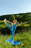 Yoga practice. Red woman practicing fitness yoga Royalty Free Stock Image
