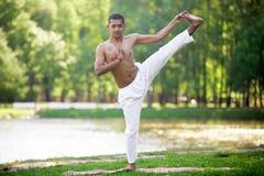 Yoga practice on riverbank Stock Photos