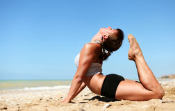 Yoga practice at the sea beach Royalty Free Stock Photography