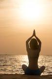 Yoga practice at sea shore Royalty Free Stock Image