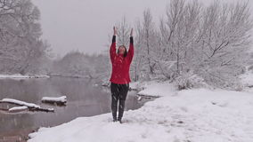 Yoga Practice in the Snow stock footage