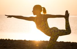 Yoga practice at sunrise Royalty Free Stock Image