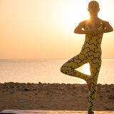 Yoga practice at sunrise Royalty Free Stock Photography