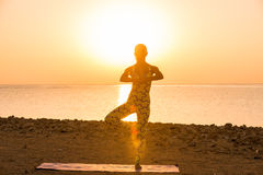 Yoga practice at sunrise Stock Photo