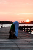 Yoga practice during sunset Stock Photography