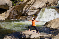Yoga Practice at Waterfall Stock Photo
