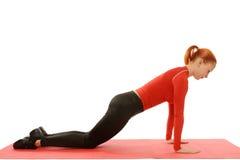 Yoga practice. Woman doing asana. Fitness pushups Stock Photo