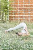 Yoga practicing in the park. A girl practicing yoga in the park Stock Images