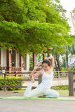Yoga practicing in the park. A girl practicing yoga in the park Royalty Free Stock Image