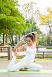 Yoga practicing in the park. A girl practicing yoga in the park Stock Photography
