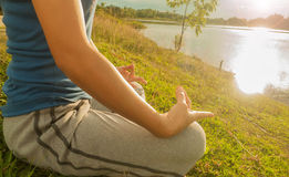 Yoga practicing at sunset, meditation Stock Photo