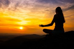 Yoga practicioner in sunset Stock Photography