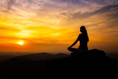 Yoga practicioner in sunset Stock Images