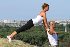 Yoga practising. Female and male yoga instructors practising in nature Royalty Free Stock Photos