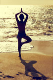 Yoga pray. A vintage yoga pray position on a beach Royalty Free Stock Photo