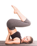 Yoga. Pretty woman is exercising yoga on white background Stock Images