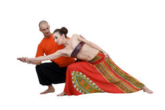 Yoga. Professional coach helps to perform asana Stock Image