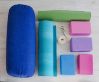 Yoga props blocks, strap, roller and carpet. Varicoloured yoga props blocks, strap, roller and carpet Royalty Free Stock Photo