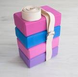 Yoga props blocks with strap. Varicoloured yoga props blocks with  buttoned strap Royalty Free Stock Photography