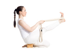 Yoga with props, Krounchasana Pose Stock Photography