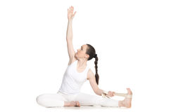 Yoga with props, Parivrtta Janu Sirsasana Royalty Free Stock Photography