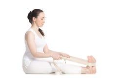 Yoga with props, paschimothanasana royalty free stock images