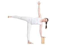 Yoga with props, pose Ardha Chandrasana Royalty Free Stock Photo