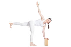 Yoga with props, pose Parivritta Ardha Chandrasana Stock Photo