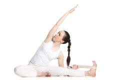 Yoga with props, Revolved Head to Knee pose Royalty Free Stock Images
