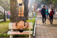 Yoga on a public bench Royalty Free Stock Photos