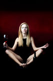 Yoga and red wine Royalty Free Stock Photos