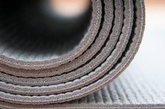 Yoga reel. Gray yoga mat in detail mode Stock Photography