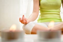 Yoga and Relax. Beautiful young woman doing yoga exercise and meditating at home Stock Photography