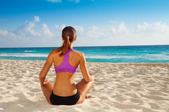 Yoga relaxation on the beach Stock Photo