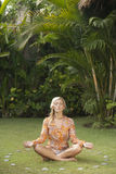 Yoga Relaxing Woman on Grass. Royalty Free Stock Photography