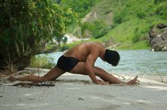 Yoga by the river Royalty Free Stock Photography